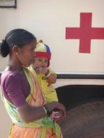 Milestones-2008-India-mobile-hosp-1-woman-baby-GnM092