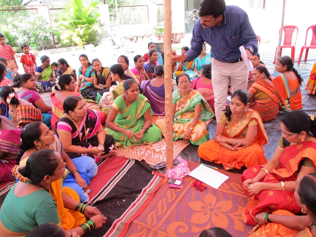 Women in groups at a training session at Ambarbhui